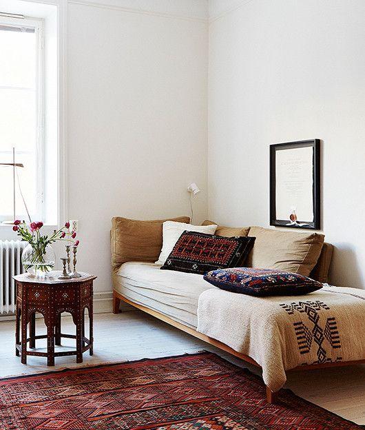 minimalist sitting area Moroccan coffee table Moroccan area rug Moroccan throw pillows