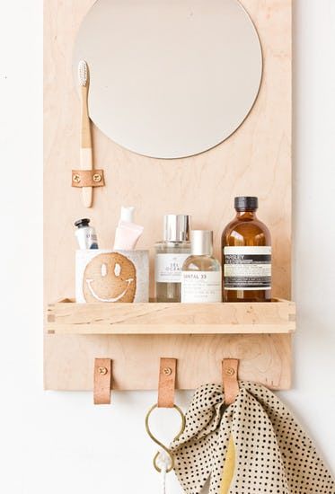 mirror storage idea with light wood backdrop