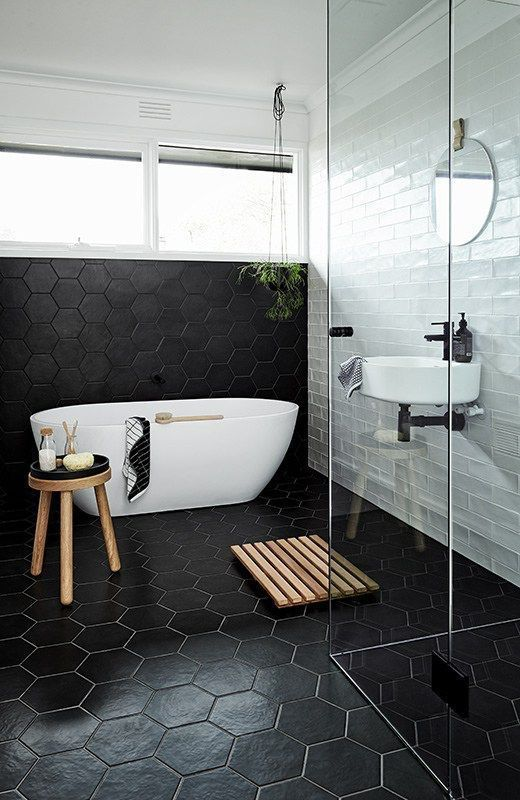 modern white bathtub wood stool wood bathroom mat clear glass shower paneling idea floating sink round and frameless mirror