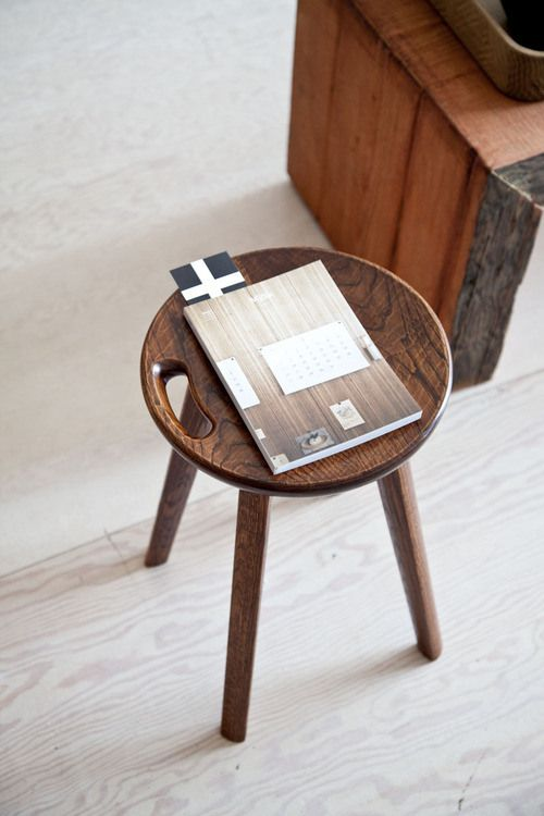 simple dark wood stool with natural stains