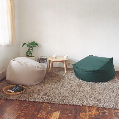 smaller living room body fit floor cushions gray area rug dark wood plank floors white walls