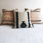 Three Pieces Of Ethnic Accent Pillows In Neutral Tones