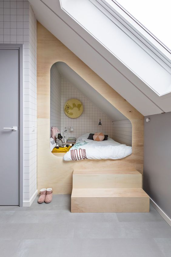 tiny attic with skylight and tiny loft bed made of light wood