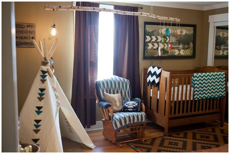 tribal themed nursery room ornate interior tent in white tribal patterned nursery chair wooden baby crib branch for lamp and toys