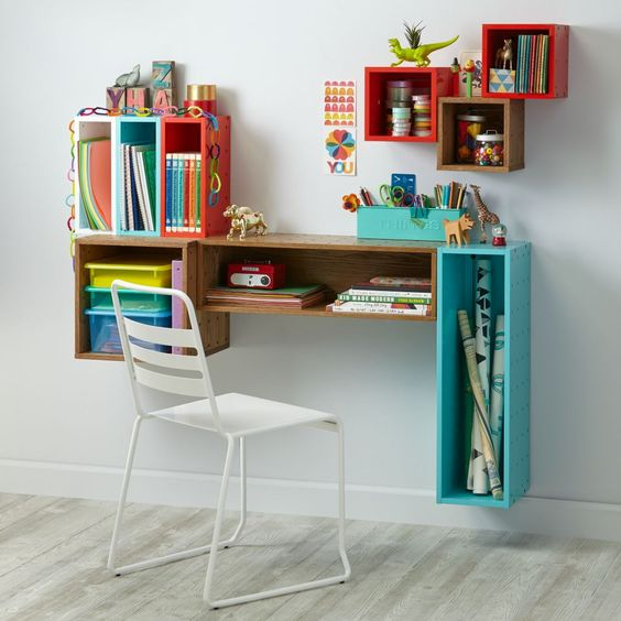 white chair wall mounted tiny wood table with under shelf colorful compact shelving unit around the table