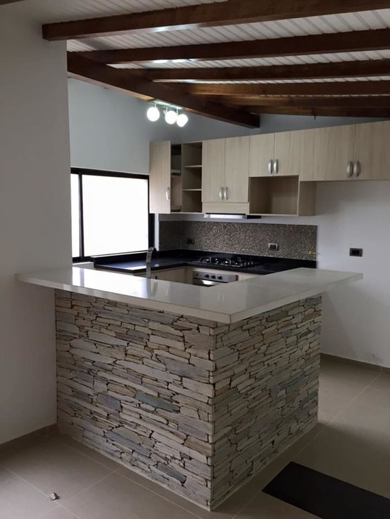 white gloss top kitchen island with exposed stone base