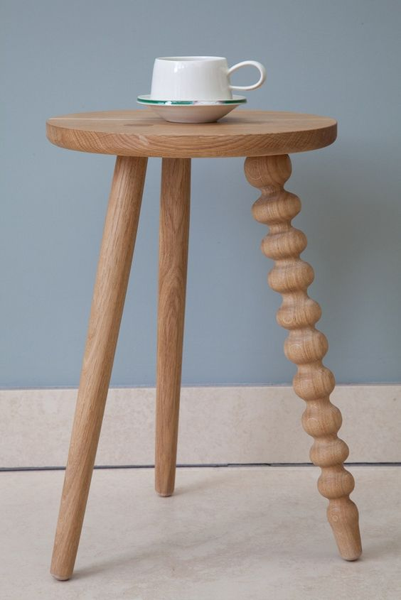 wooden side table with round shaped top and spiral leg