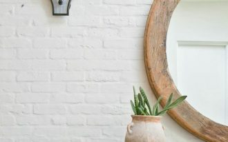 accent brick wall in white unique wall sonce wood framed wall mirror in round shape wood hall console