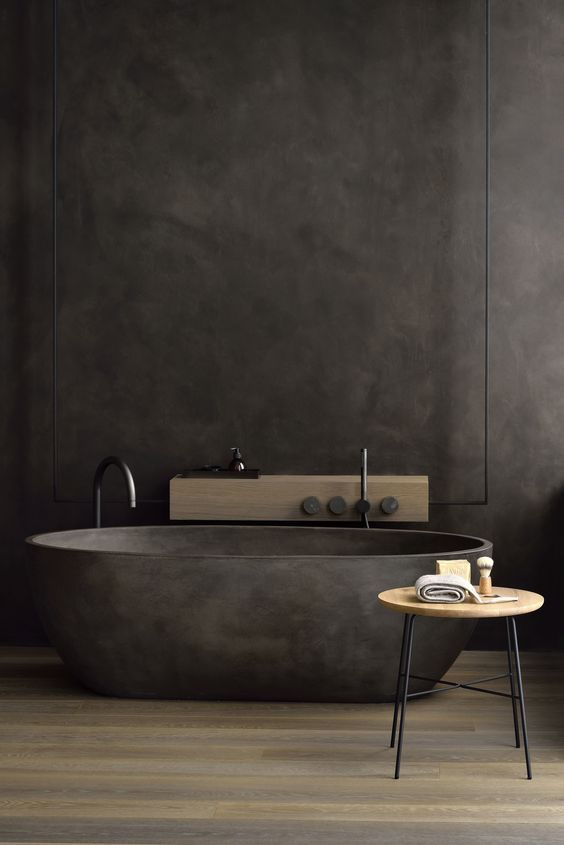 elegant black bathroom matte black bathtub free standing faucet in black stool with round wood top and black metal legs dark wood floors