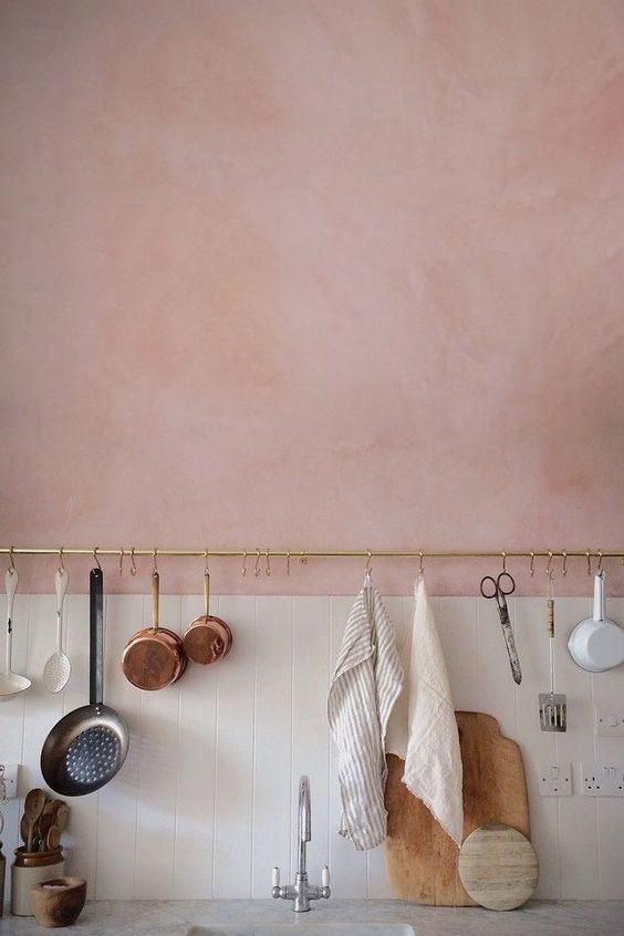 half light pink half white tile walls with single brass finish wire with hooks