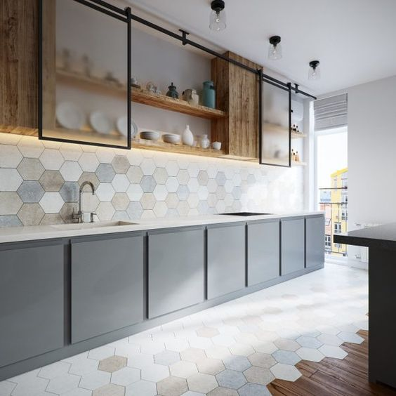 half way wood half way hexagon tile floors white top kitchen counter with soft gray structure soft colored hexagon tile backsplash hardwood upper cabinets with sliding foggy like glass doors