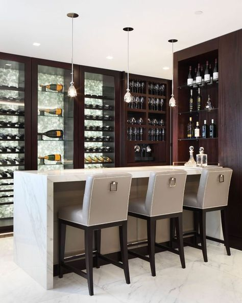 masculine look home bar design dark wood drink storage with glass door white countertop modern style bar stools with back