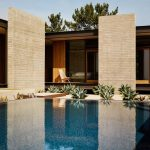 Outdoor Pool Reflecting Back The Beauty Of Exterior And Plants