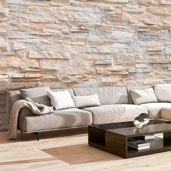 rocky wall texture in light shade and rough surface modular sofa in white minimalist coffee table with glass top