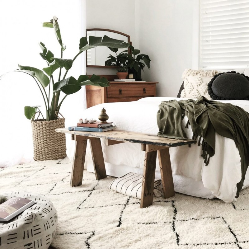 shabby wooden bench bed white bedding treatment modern white shag rug with geometric patterns modern white beanbag with black line patterns greenery with woven planter