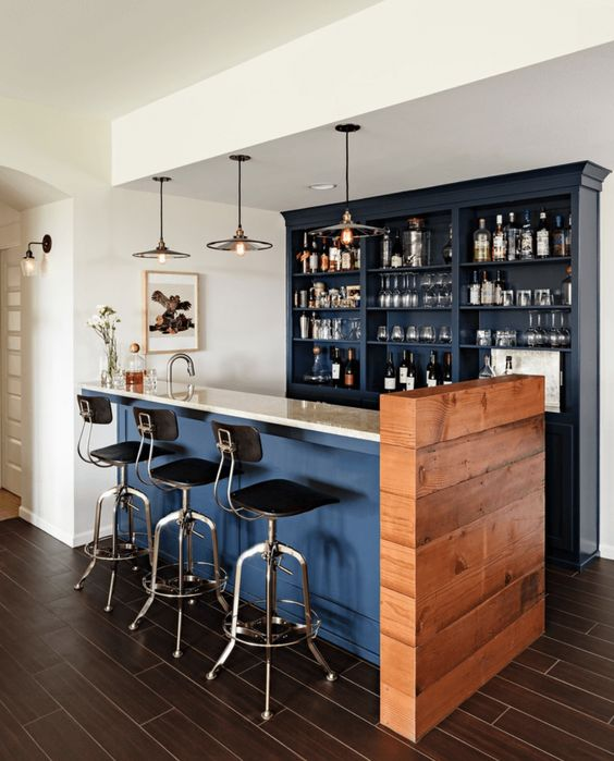 small home bar navy blue counter with bright countertop modern industrial bar stools with iron frame and black leather cushion navy blue drink shelves hardwood panel modern industrial pendants