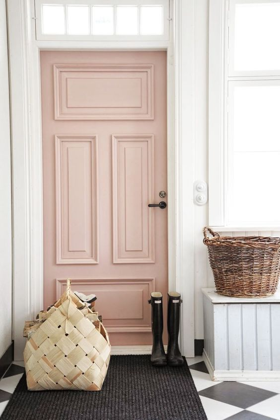 soft pink front door black runner ornate baskets black white tile floors