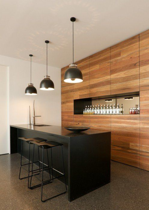 ultra modern home bar minimalist black counter black stools all flat wooden walls with recessed display shelf large pendants with black lampshade