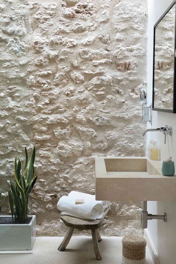 wall texture in white built in sin with wall mounted stainless faucet low profile wood stool concrete planter for houseplant