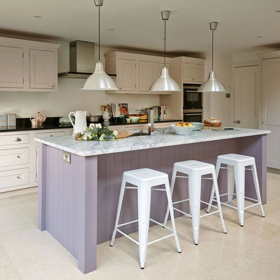white classic kitchen island traditional style kitchen cabinets in white black countertop traditional style pendants with gloss white lampshades modern white stools marble top kitchen island