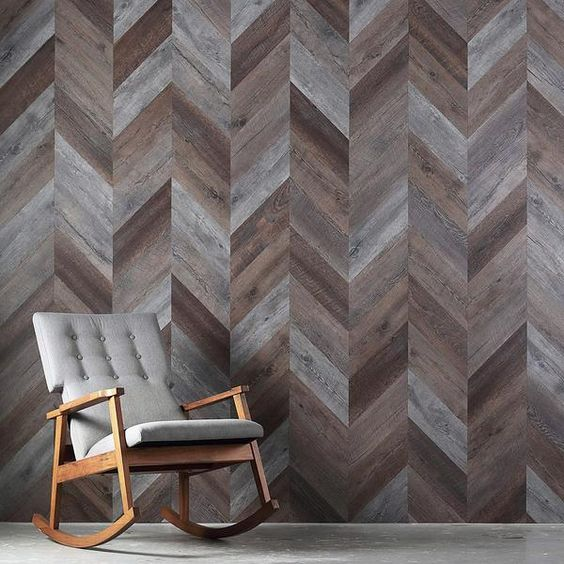 wood planks shaped in herringbone patterns rocking chair with gray cushion
