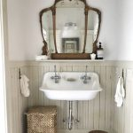 Antique Mirror With Wood Crafted Frame Farmhouse Sink In White Ornate Woven Basket For Cloth Small And Low Profile Wood Stool
