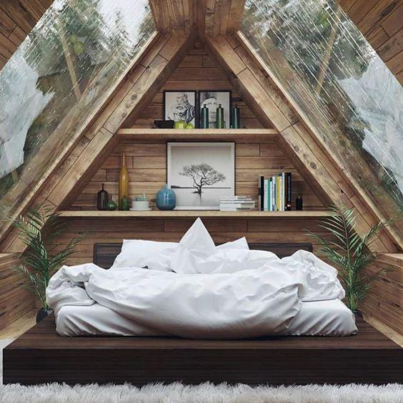 attic bedroom idea with clear glass panels recessed book shelves platform bed crisp white bed linen crisp white duvet cover white shag rug