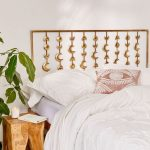 Bed Frame With Moon Headboard In Gold Tone Tree Trunk Bedside Table Crisp White Bedding Treatment And Pillows