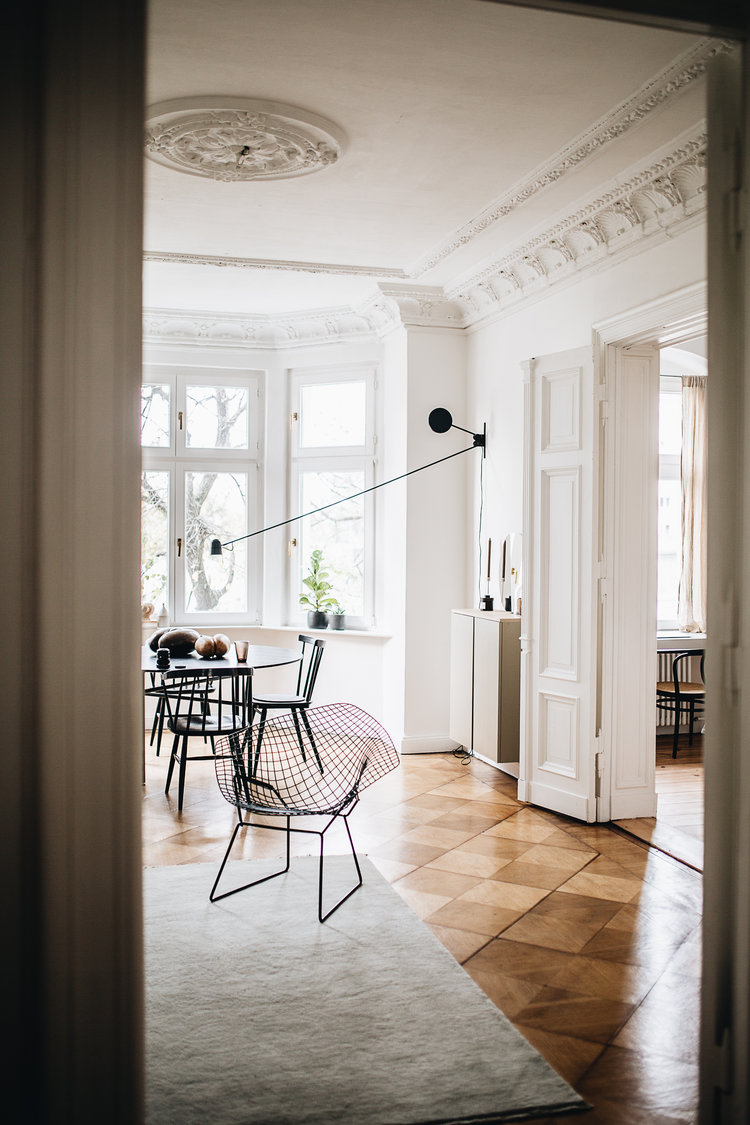 crisp white walls and ceilings with craft details earthy brown tile floors white area rug modern furniture set