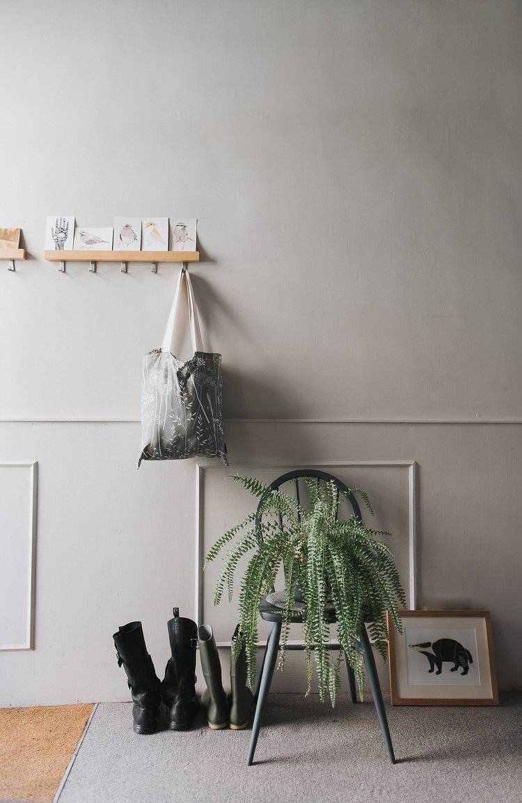 deep gray chair for greenery wall attached cloth and bag hangers gray area rug light gray walls with baseboard