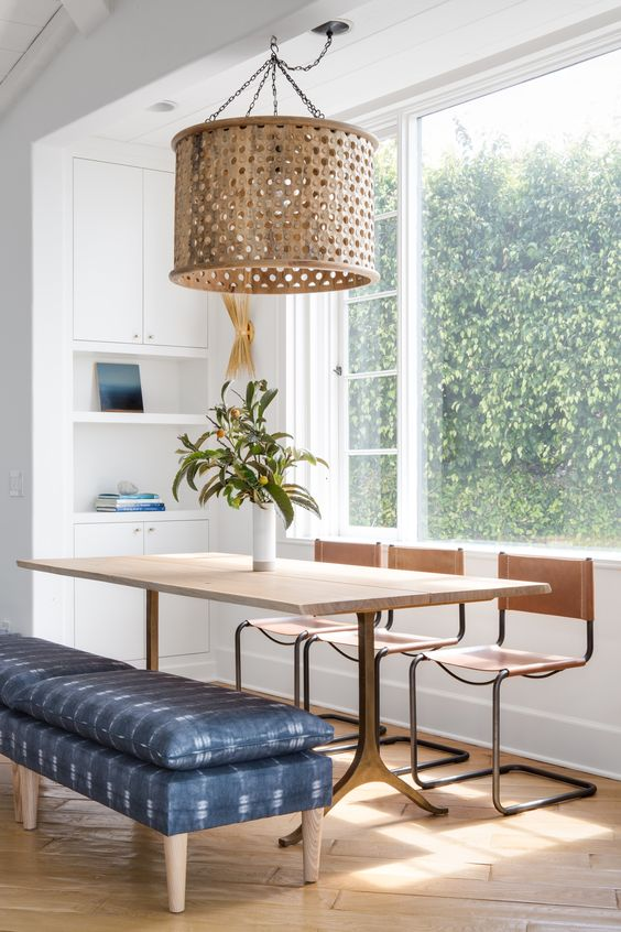 large pendant with many holes on brass lampshade modern minimalist dining furniture bench seat with blue cushion