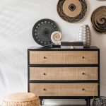 Low Profile Rattan Stool Cabinet With Woven Door Panels African Art Inspired Wall Decors