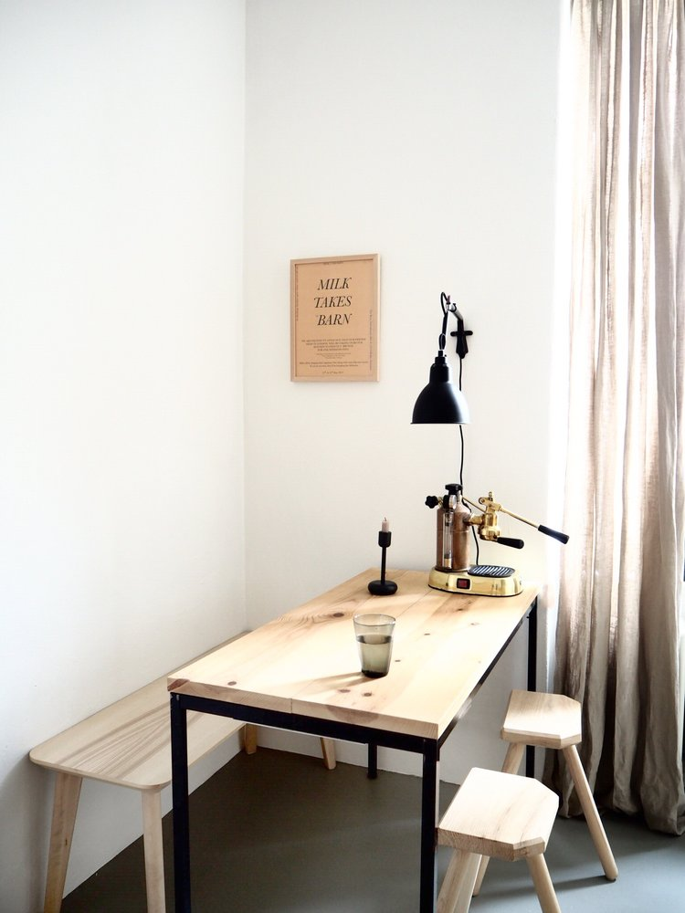 organic wood furniture with black accents black pendant