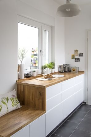 practical and minimalist kitchen idea with built in bench seat with wood top and white base wood countertop with white base