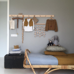 Rattan Bed Frame Modern Rug With Black Accents And Fringed Trims Wood Cloth Hanger Old Look Suitcase As The Bedside Table