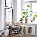Rattan Chair With Blue Throw Pillow Plants On Pot