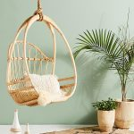 Rattan Hanging Chair With White Throw Pillow Huge Planters With Tropical Houseplants
