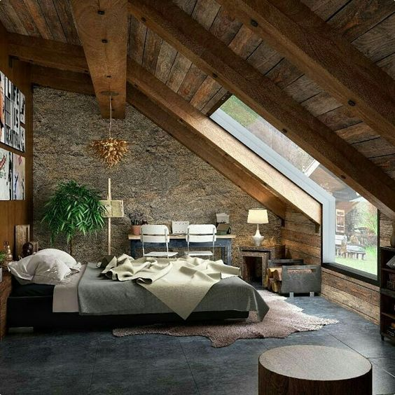 rustic bedroom with unique glass window bed furniture stoned wall hardwood ceilings working desk and chair