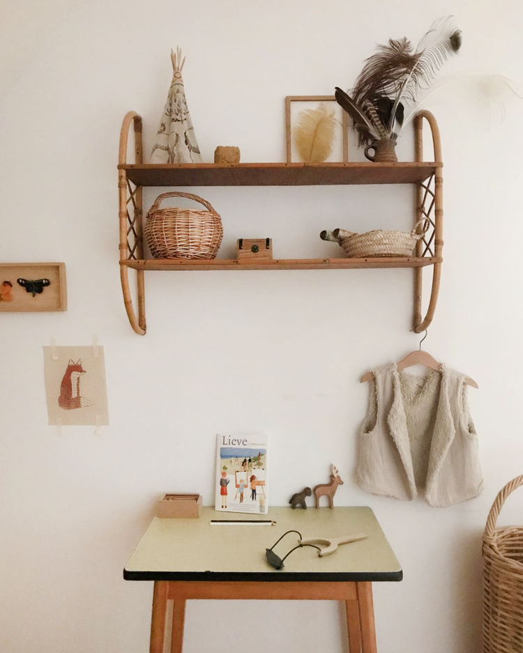shelving unit with rattan accents on both sides