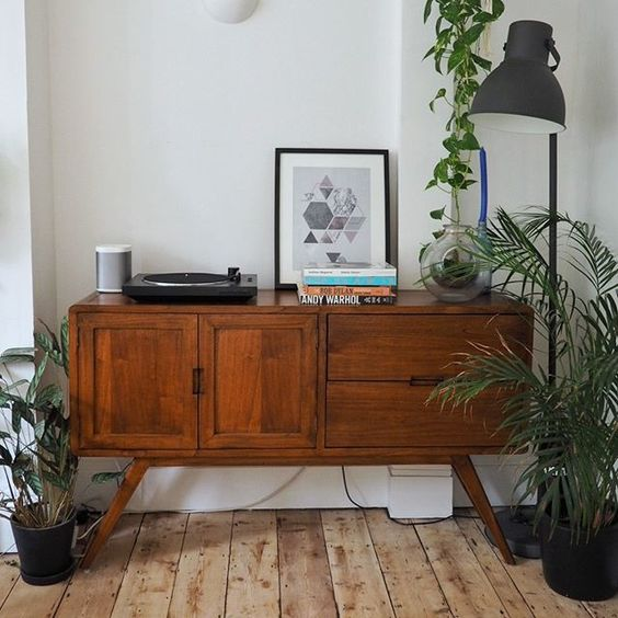 wooden console table some greenery
