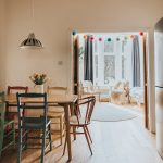 Wooden Dining Chairs Wooden Dining Table Green Dining Chair Blue Dining Chair Old Look Pendant Colorful Pompoms Above The Door