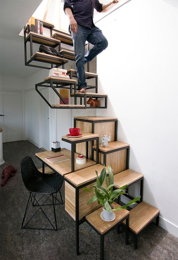 contemporary staircase with workspace underneath