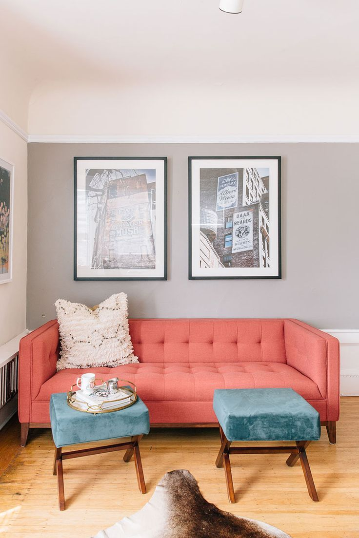coral tufted upholstery sofa in midcentury modern style x base stools with square blue velvet top cowhide rug