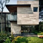 Earthy House Architecture With Wood And Green Dominance