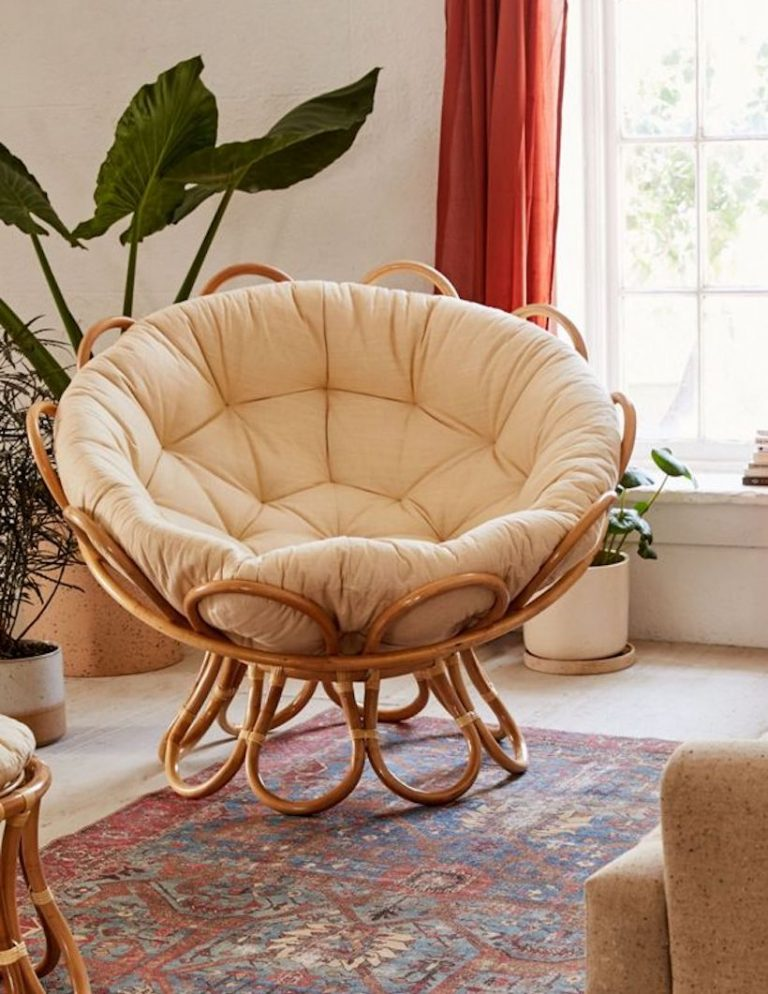 egg chair with rattan frame and tufted cushion