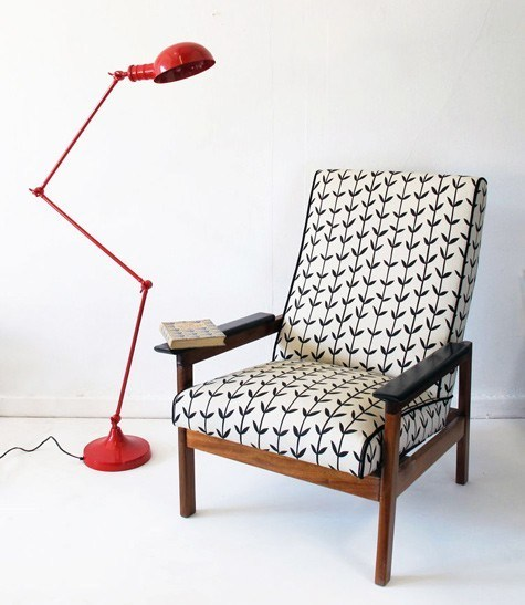 midcentury modern accent chair with floral prints vividly red floor lamp in modern style