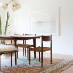 Modern Boho Dining Room Dark Wood Dining Furniture Set Multicolored Area Rug With Tassels Light Wood Floors Crisp White Walls