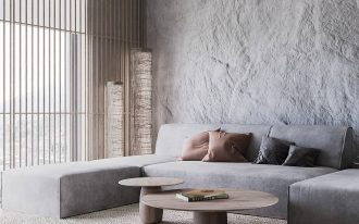 modern minimalist living room with ultra light gray sectional round wood shaped coffee tables flat woven area rug textured hard concrete walls in light tone