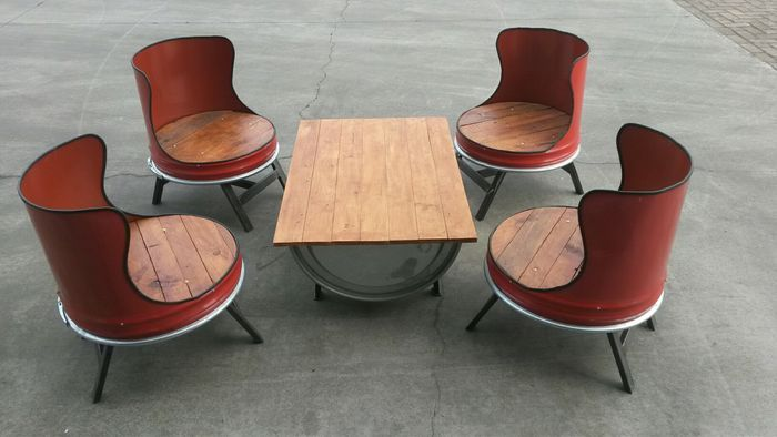 outdoor chairs and table made from oil drum and wood