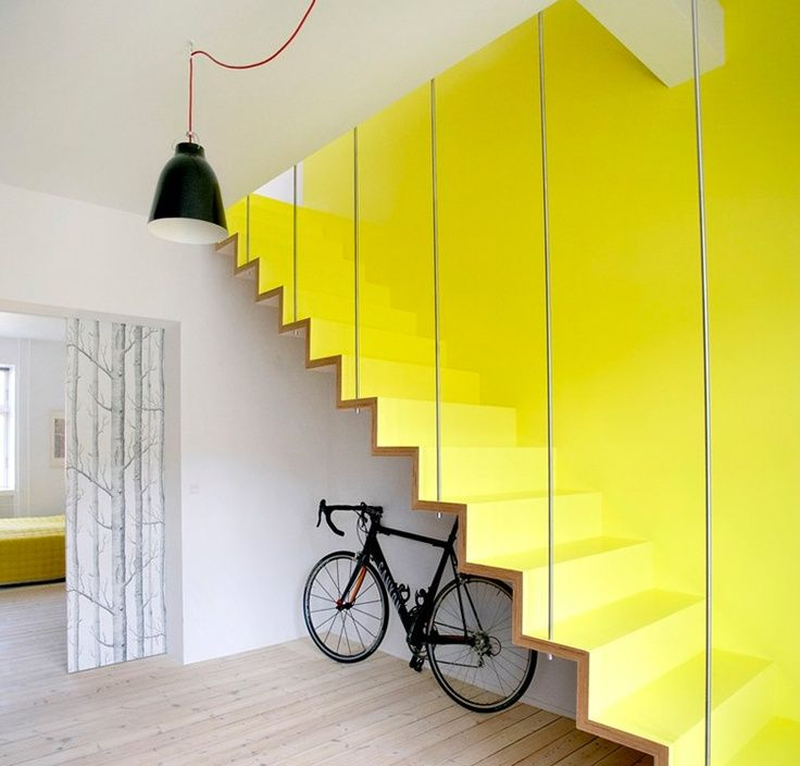 simple and ultra modern staircase in yellow yellow wall accent light wood floors